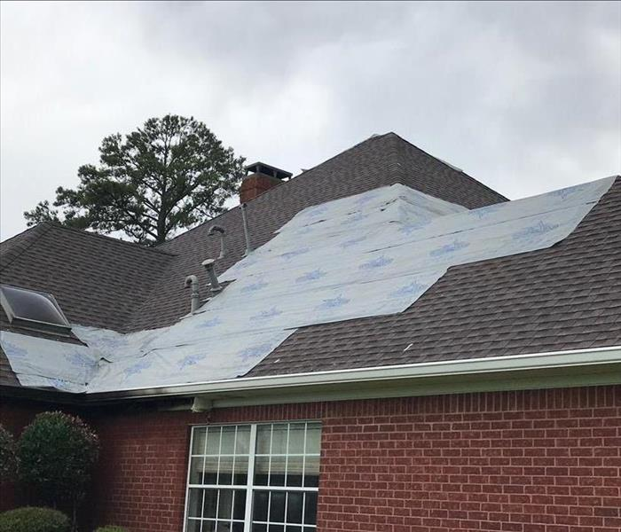 Completed roof work on a home after a fire.