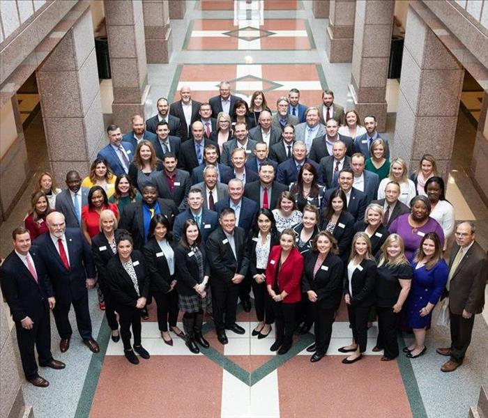 Representatives from Lufkin take a group photo at the Capitol in Austin.