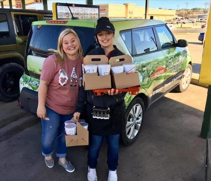 Candice Stott and a Sonic carhop loading up drinks for Hudson ISD Teachers.