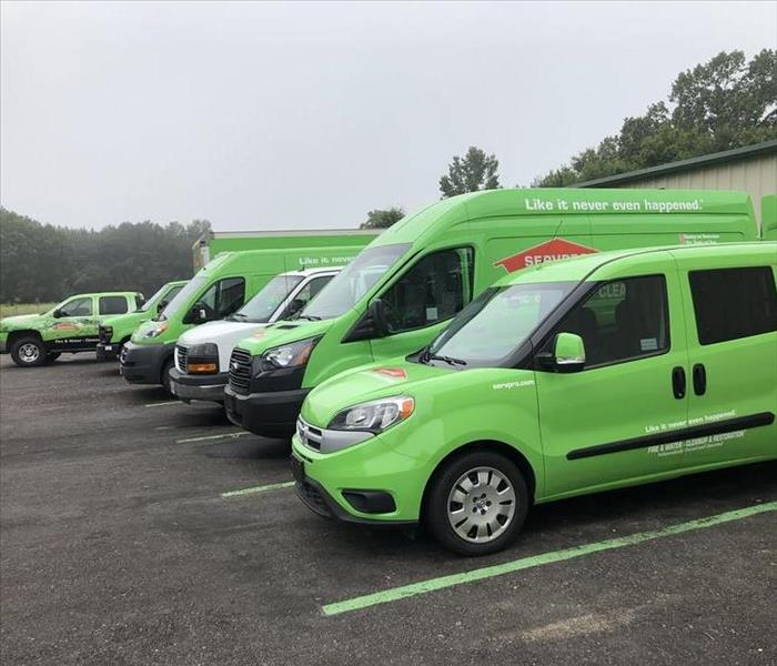 New Green SERVPRO vehicles parked in the SERVPRO of Lufkin lot, ready to go.