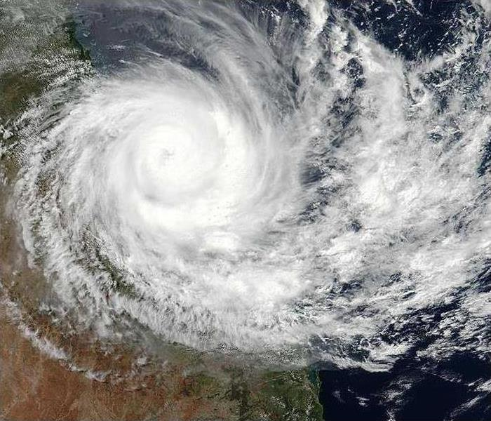 A satellite image of a hurricane making landfall.